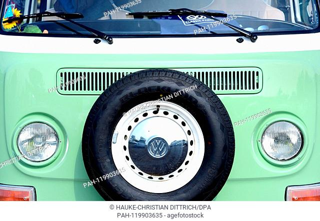 A VW T2 with the logo of Volkswagen on it at the Maikaefertreffen (May Beetle Meeting) in Hanover (Germany), 01 May 2019