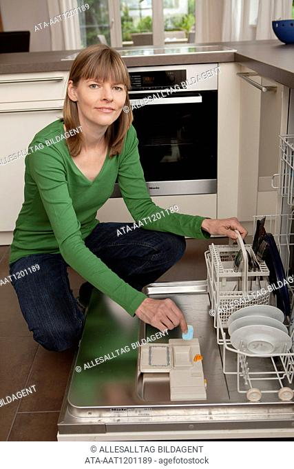 Woman in front of the dishwasher