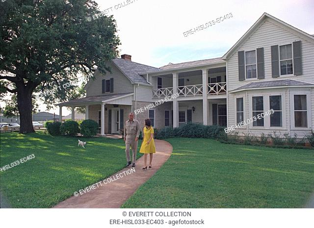 President Lyndon Johnson, Lady Bird, and their dog Yuki in front of their House on the LBJ Ranch. May 15, 1968