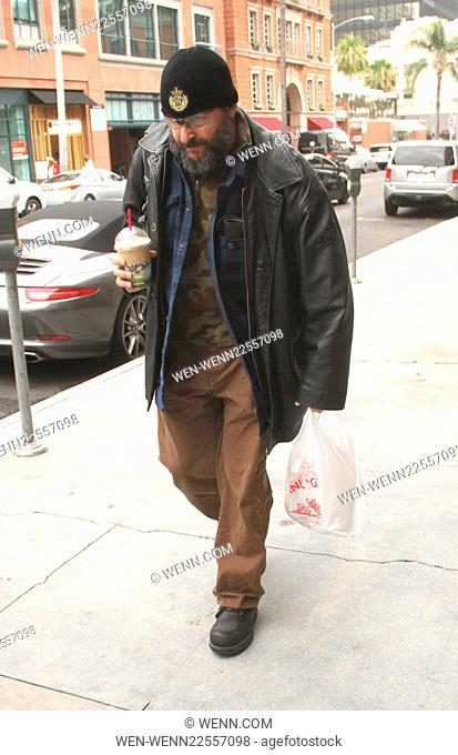 Judd Nelson out and about in Beverly Hills walking in heavy workman boots, leather jacket and a beanie hat with industial safety glasses Featuring: Judd Nelson...
