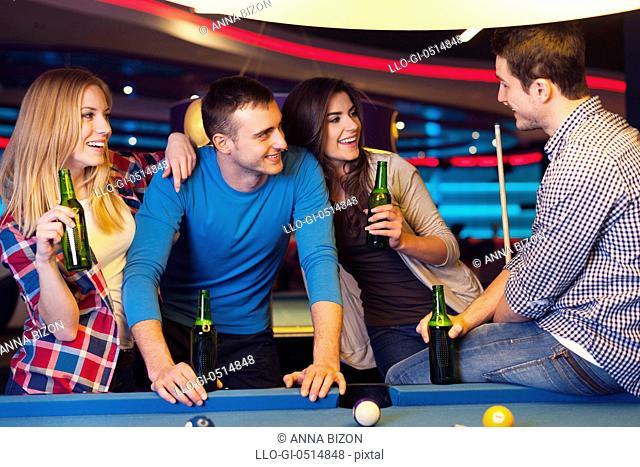Friends on party in billiard club. Rzeszow, Poland