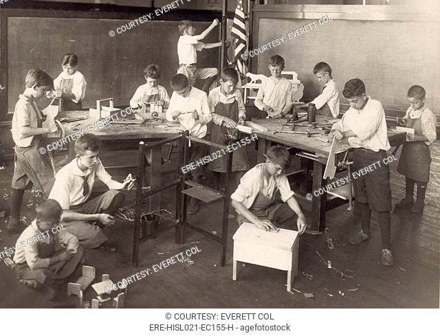 Boys learn carpentry in an open air summer school in Chicago in 1917