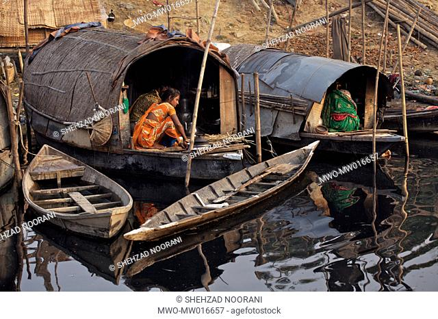 Hundreds of families live in boathouses on the bank of the Shitalakhya River just under Tongi bridge on the outskirts of Dhaka city These little dingy boats...