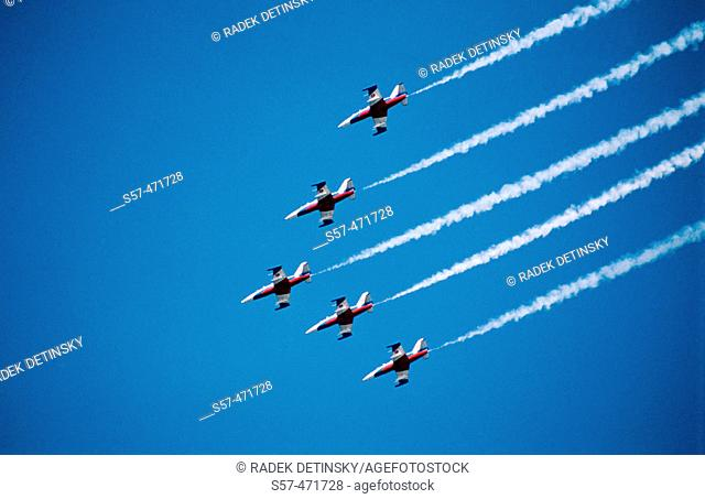 vapour trails of five military aircrafts