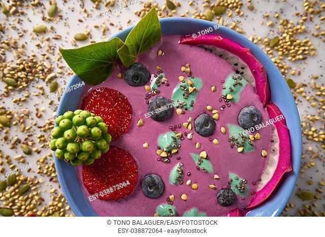 Acai bowl smoothie with chia strawberry blueberry seeds and pitaya dragon fruit
