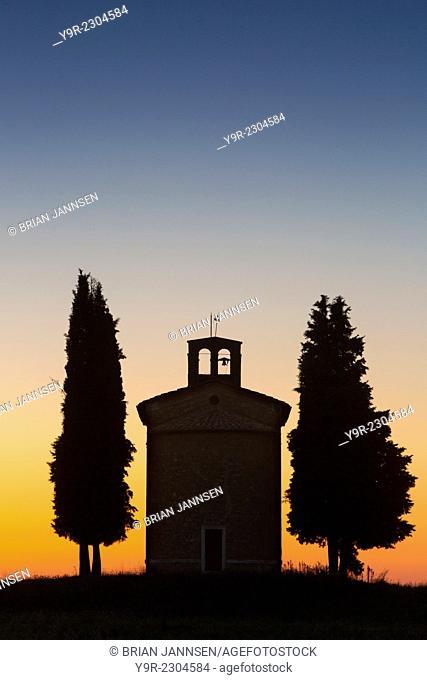 Twilight over the tiny Cappella di Vitaleta near San Quirico d'Orcia, Tuscany, Italy