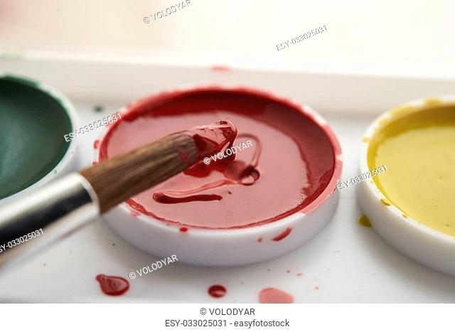 brush in red paint