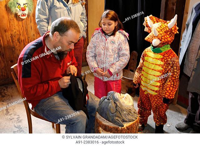 Switzerland, Valais, Val d'Herens, village of Evolene, Carnaval, Mr Beytrison carving traditional masks