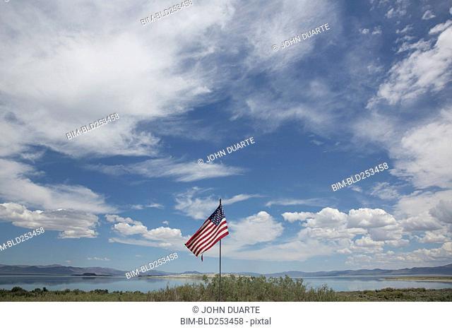 American flag under cloudy sky