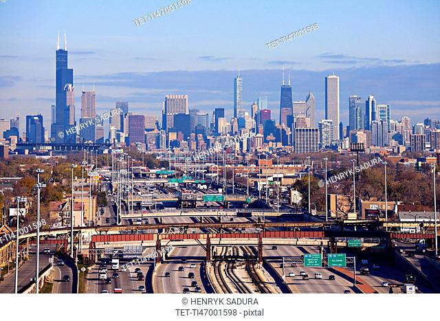 Illinois, Chicago, Urban scene with car traffic and skyscrapers in distance