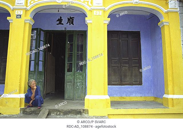 Woman in front of house Hoi An Vietnam