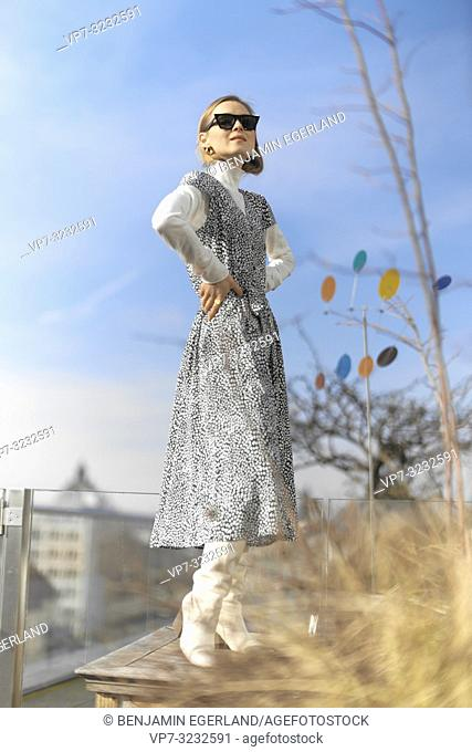 well-dressed blogger woman with stylish outfit, wearing dress, outdoors in Munich, Bavaria, Germany