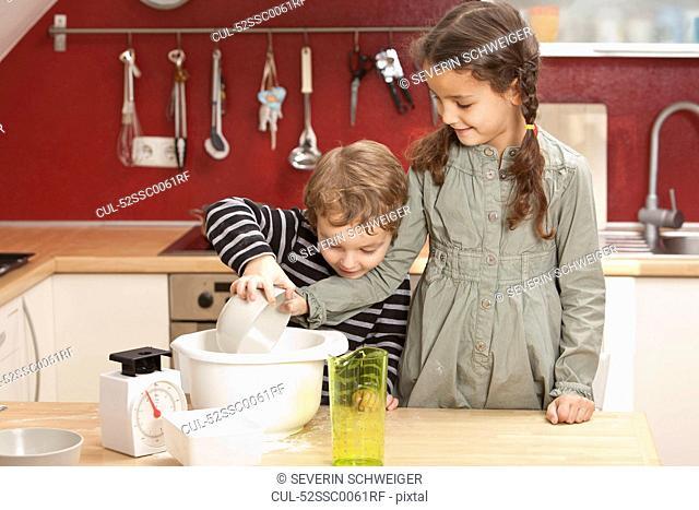 Children cooking together in kitchen