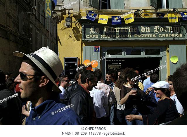 Group of people standing in the front of a cafe, Provence, France