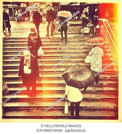 Muscovites on steps in the rain, Moscow, Russian Federation, eastern Europe