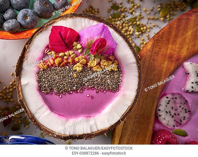 Acai bowl smoothie inside coconut chia granola blueberry and pitaya dragon fruit