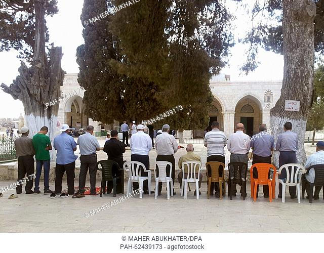 A group of Palestinian men who call themselves 'Murabitun' have gathered for their noon prayer in front of the mosque on the Temple Mount in Jerusalem, Israel