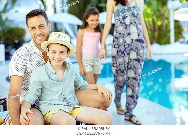 Family enjoying themselves by swimming pool