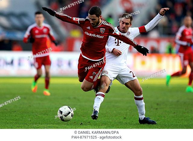 Ingolstadt's Mathew Leckie (r) and Bavaria's Philipp Lahm in action during the Bundesliga soccer match between FC Ingolstadt 04 and Bayern Munich at the Audi...