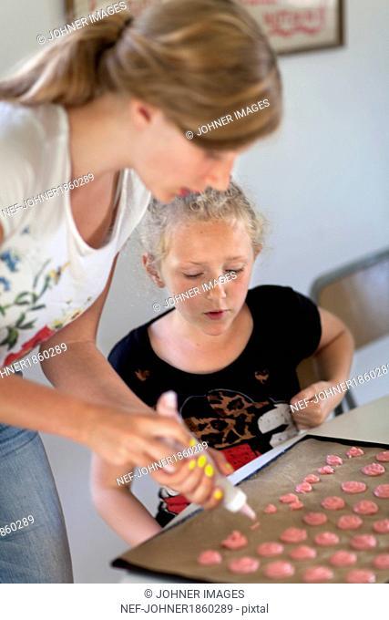 Sisters baking cookies