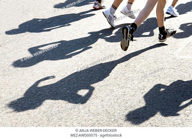 Germany, Stuttgart, Marathon runners, low section