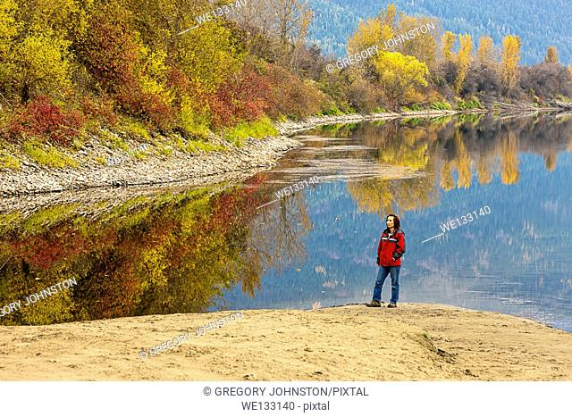 A woman takes in the beauty of the Kootenai River in autumn