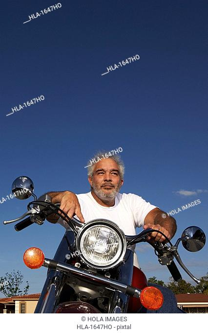 Mature man sitting on a motorcycle