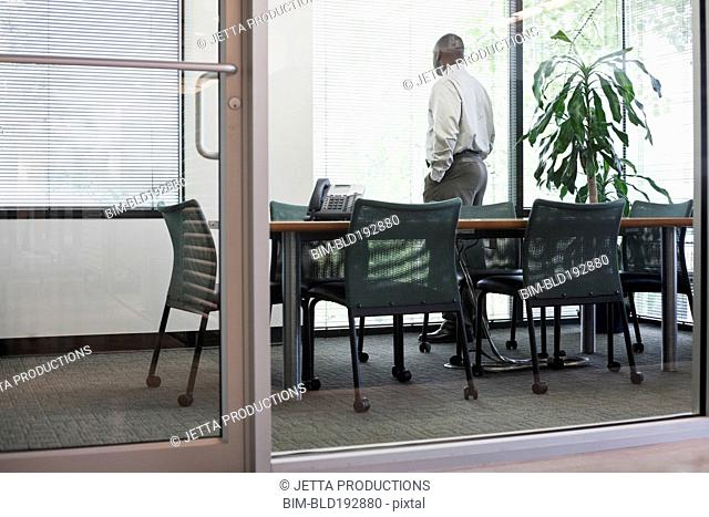 African man waiting in conference room