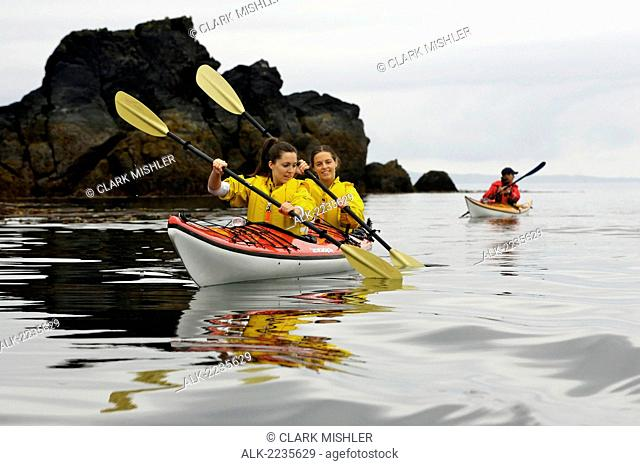 Visitors On A Guided Sea Kayaking Tour Out Of Ketchikan In Southeast Alaska