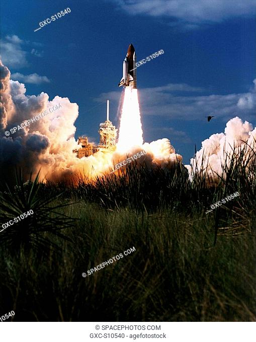 11/19/1996 -- Vividly framed by a tranquil Florida landscape, the Space Shuttle Columbia lifts off from Launch Pad 39B at 2:55:47 p.m. EST, Nov