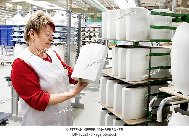 Employee during the final inspection of Rosenthal vases, in the production of tableware at the porcelain manufacturer Rosenthal GmbH, Speichersdorf, Bavaria