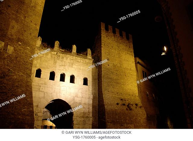 ancient roman porta tiburtina arch wall at night in san lorenzo area, rome, italy