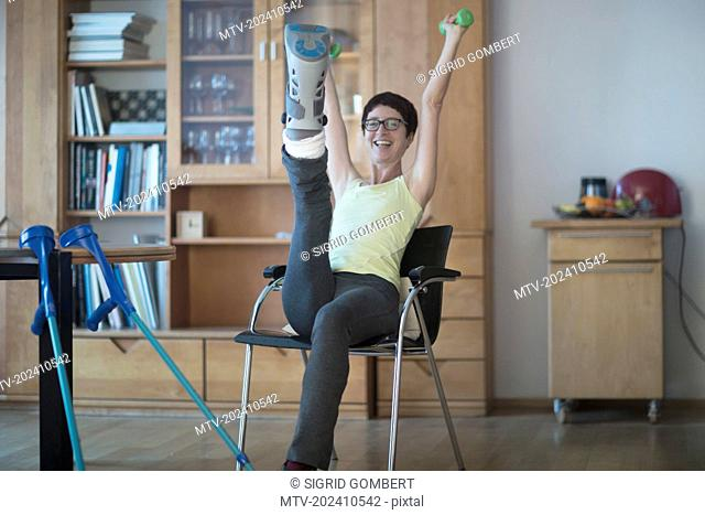 Woman with broken leg doing workout at home