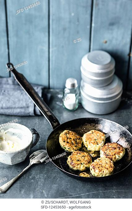 Curried fish cakes with a yoghurt dip