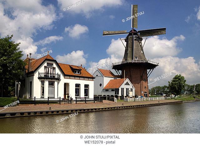 Windmill the Zwaluw along the river Dokkumer Ee in the frisian village Burdaard