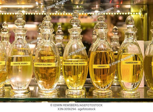 Beautiful glass bottles of perfume sitting on a shelf in Istanbul Spice bazaar in Turkey