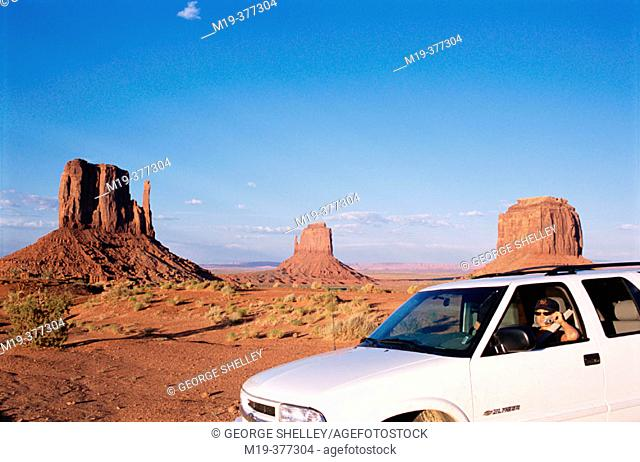 girl on a cell phone in Monument Valley  usa