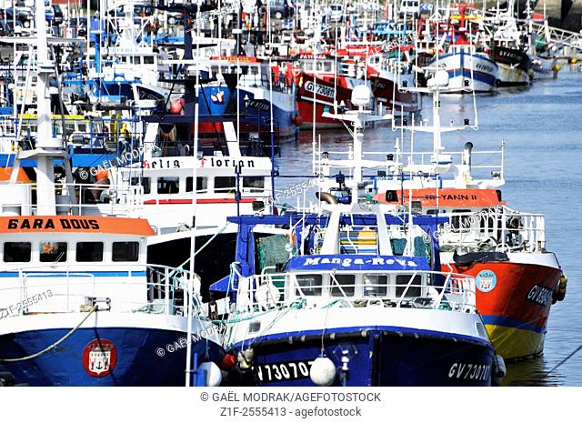 Le Gulvinec and its armada made with colored fishing boats in Brittany, France