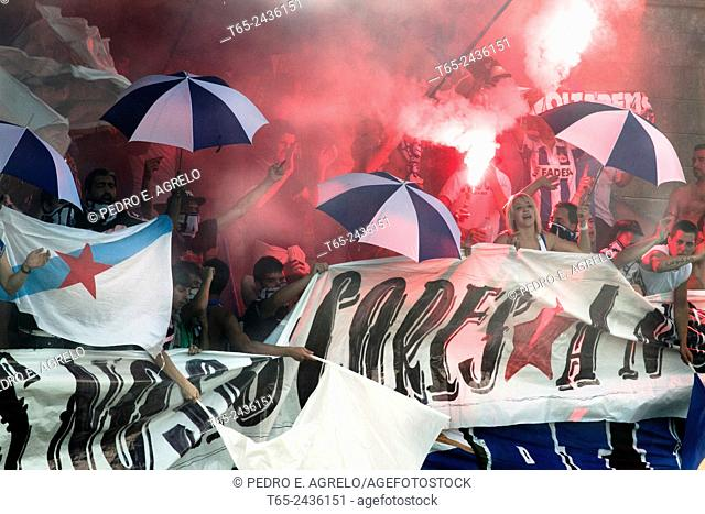 Fans of a football team, followers of Club Deportivo Coruna, with flares in a friendly match with a team of third division in Villalba, Lugo