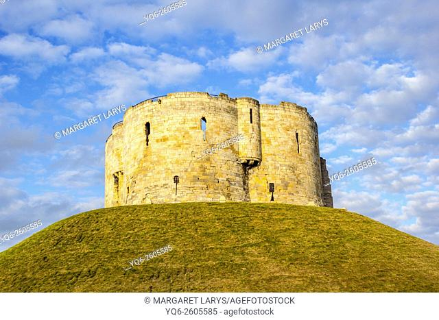 Clifford's Tower against blue sky, York, North Yorkshire, England, UK
