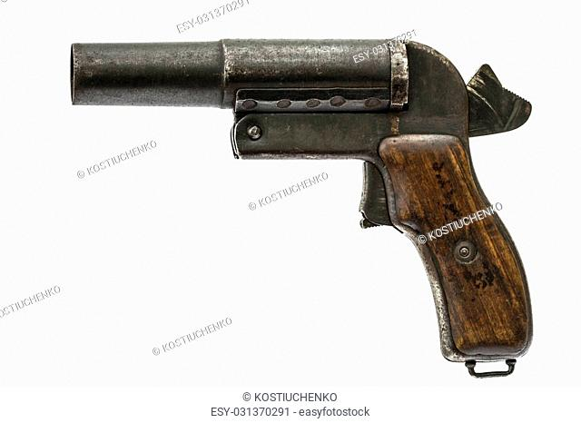 Old signal pistol, flare gun with the hammer cocked, isolated on white background