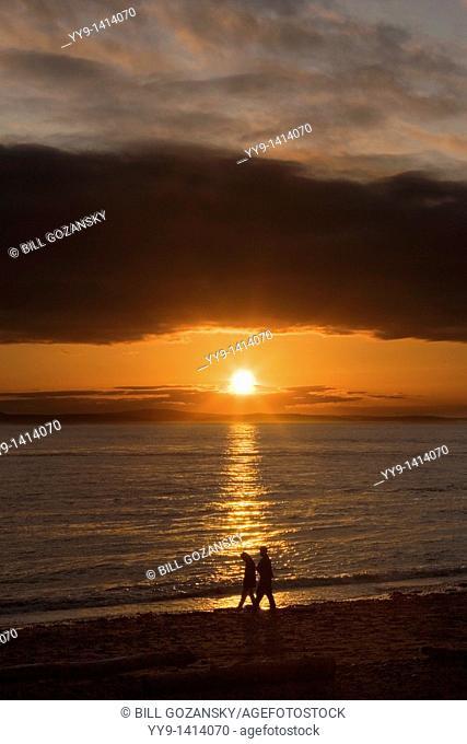 Couple walking in sunset - Deception Pass State Park - Washington