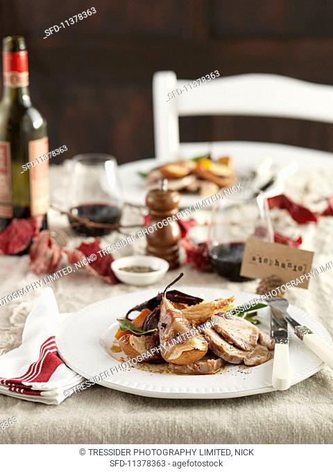 Roast lamb with bacon pears and vegetables