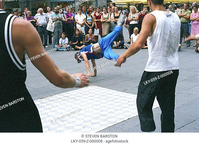 B-boys breakdance for outdoor crowd