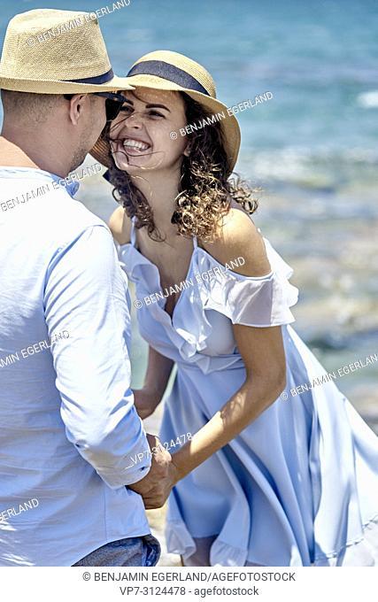 vital woman smiling at boyfriend, couple, love, holidays