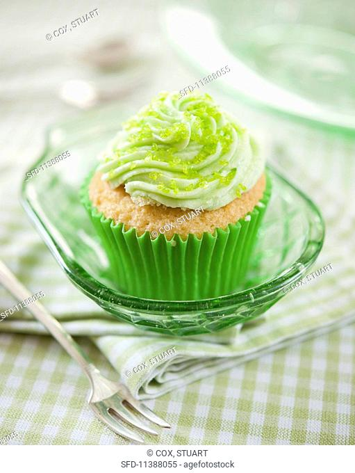 A citrus cupcake with green sugar