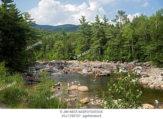 Conway, New Hampshire - Swimmers on a hot summer afternoon at the lower falls of the Swift River in White Mountain National Forest