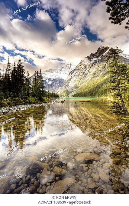 Mount Edith Cavell reflected in Cavell Lake, Jasper National Park, Alberta, Canada