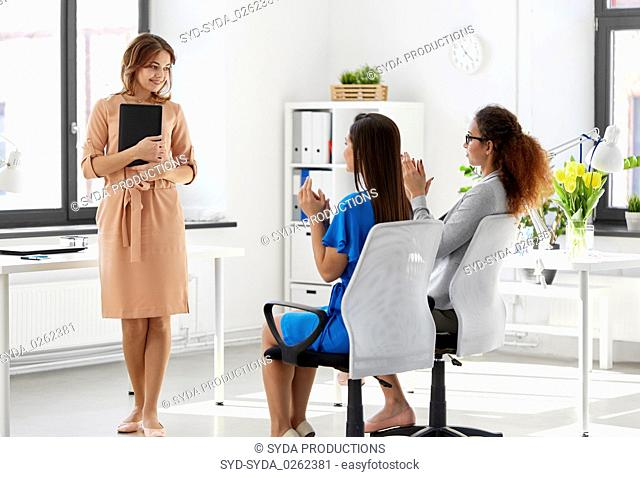 business team applauding to woman at office
