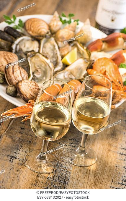 Fresh seafood platter with lobster mussels and oysters and white wine
